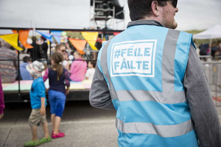 Designer Ciaran O'Melia wearing one his own high-vis #FéileFáilte jackets